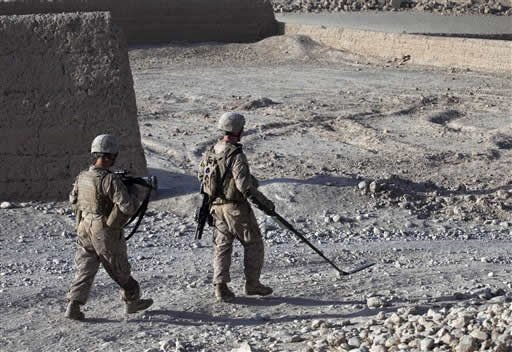 FILE - In this Sept. 5, 2011 photo, U.S. Marines patrol with the help of a metal detector, in Sangin district, Helmand province. (AP Photo/Brennan Linsley, File)