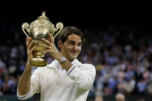 Roger Federer of Switzerland celebrates with the trophy after winning the men's singles final against Andy Murray of Britain at the All England Lawn Tennis Championships at Wimbledon, England, Sunday, July 8, 2012. (AP Photo/Kirsty Wigglesworth)