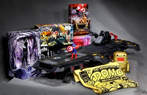 In this July 5, 2012 photo, the Marvel Universe S.H.I.E.L.D. Super Helicarrier, at center with a Captain America figure on the foredeck, is seen with, from left background, a DC Comics Vertigo Death figurine, the Polly Pocket DC Comics Villain set.