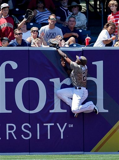 SECOND IN A SERIES OF THREE PICTURES - San Diego Padres center fielder Cameron Maybin robs Cincinnati Reds' Joey Votto of a home run to end the fifth inning of a baseball game, Sunday, July 8, 2012, in San Diego. (AP Photo/Lenny Ignelzi)
