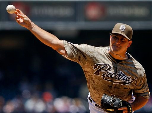 San Diego Padres starting pitcher Jason Marquis throws to the Cincinnati Reds during the first inning of a baseball game, Sunday, July 8, 2012, in San Diego. (AP Photo/Lenny Ignelzi)