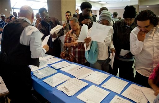 In this Thursday, May 31, 2012, job seekers gather for employment opportunities at the 11th annual Skid Row Career Fair at the Los Angeles Mission in Los Angeles. (AP Photo/Damian Dovarganes, File)