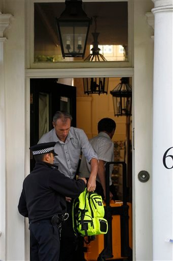 Police investigation officers arrive at the home of Britain's richest women, American-born Eva Rausing who was found dead in her home in Belgravia, London, Wednesday, July 11, 2012. (AP Photo/Sang Tan)