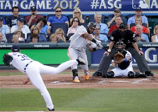 National League's Pablo Sandoval, of the San Francisco Giants, hits a three-run triple on a pitch by Justin Verlander, of the Detroit Tigers, in the first inning the MLB All-Star baseball game Tuesday, July 10, 2012. (AP Photo/Charlie Neibergall)