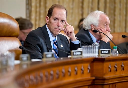 """House Ways and Means Committees Chairman Rep. Dave Camp, R-Mich., leads a hearing on the implications of the Supreme Court's ruling that the individual mandate in the """"Affordable Care Act"""" is constitutional. (AP Photo/J. Scott Applewhite)"""
