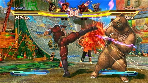 """In this publicity photo provided by Capcom, a scene with M. Bison vs. Kuma from the """"Street Fighter X Tekken"""" video game is shown. Capcom's """"Street Fighter"""" game franchise marks its 25th anniversary at Comic Con July 12-15, 2012 in San Diego. (AP Photo)"""