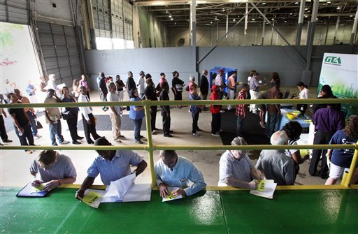 In this July 10, 2012, photo, job seekers attend a career fair hosted by GreenTech Automotive in Horn Lake, Miss. Unemployment hit a four year low, but the decline was partly due to temporary factors. (AP Photo/The Commercial Appeal, Mike Maple)