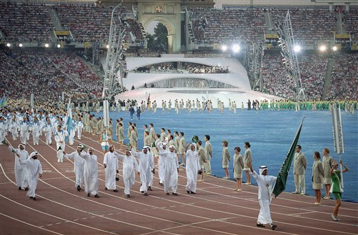 In this Saturday, July 25, 1992 file photo, members of Saudi Arabia's team walk in Olympic Stadium in Barcelona during the opening ceremonies of the XXV Olympics. (AP Photo/Cliff Schiappa, File)