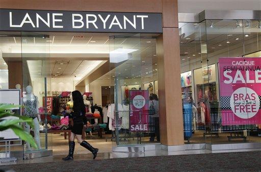 FILE- In this June 15, 2012, file photo, a woman walks into a Lane Bryant store in San Jose, Calif. (AP Photo/Paul Sakuma, File)