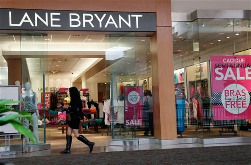 FILE- In this June 15, 2012, file photo, a woman walks into a Lane Bryant store in San Jose, Calif. (AP Photo/Paul Sakuma, File)