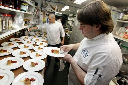 In this May 11, 2012 file photo, chef and owner Josiah Slone, right, prepares a foie gras dish at the Sent Sovi restaurant in Saratoga, Calif. California's ban on foie gras could be a boon for at least one San Francisco restaurant.