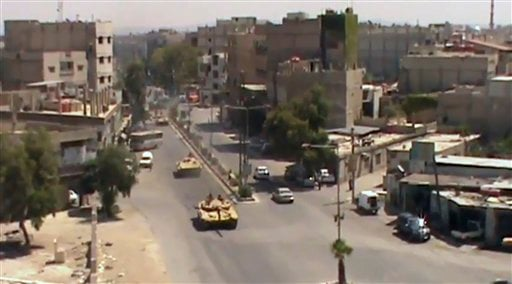 This image made from video provided by Shaam News Network Tuesday, July 17, 2012, purports to show Syrian tanks in Damascus, Syria. (AP Photo)