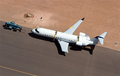 A SkyWest regional jet sits on the tarmac on the opposite end of the St. George Municipal Airport Tuesday, July 17, 2012. (AP Photo/The Spectrum, Jud Burkett)