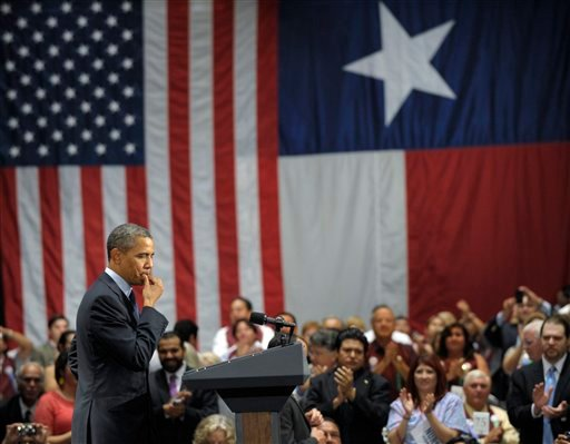 President Barack Obama pauses as he is applauded during his speech at a fundraising event at the Henry B. Gonzalez Convention Center in San Antonio, Texas, Tuesday, July 17, 2012. Obama is spending the day fundraising in Texas. (AP Photo/Susan Walsh)