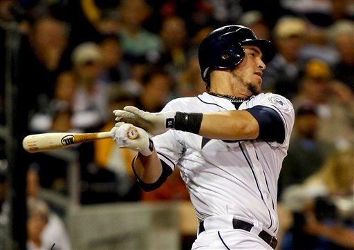 San Diego Padres' Yasmani Grandal drives in a run with a base hit to center field against the Houston Astros during the fifth inning of a baseball game Tuesday, July 17, 2012 in San Diego. (AP Photo/Lenny Ignelzi)
