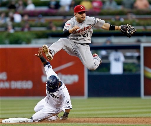 Houston Astros second baseman Jose Altuve hurdles San Diego Padres' Alexi Amarista while relaying to first to complete a double play during the first inning of a baseball game Tuesday, July 17, 2012, in San Diego. Logan Forsythe was out at first.