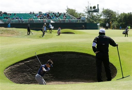Hiroyuki Fujita of Japan plays out of a bunker onto the 6th green during a practice round at Royal Lytham & St Annes golf club ahead of the British Open Golf Championship, Lytham St Annes, England, Wednesday, July 18, 2012. (AP Photo/Jon Super)