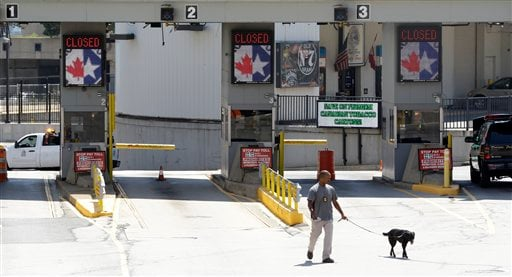 In this July 12, 2012, file photo a dog is used by authorities to investigate a bomb threat at the Detroit Windsor Tunnel Thursday, July 12, 2012.