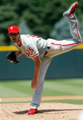 Philadelphia Phillies starting pitcher Cole Hamels works against the Colorado Rockies in the first inning of a baseball game in Denver on Sunday, July 15, 2012. (AP Photo/David Zalubowski)