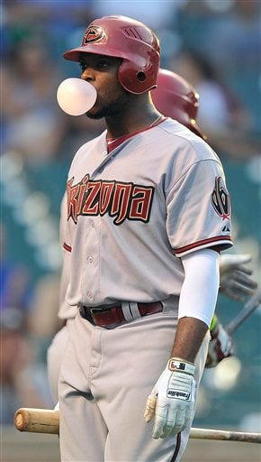 Arizona Diamondbacks' Justin Upton blows a bubble after striking out against the Chicago Cubs during the ninth inning of a baseball game, Friday, July 13, 2012, in Chicago. The Cubs defeated the Diamondbacks 8-1. (AP Photo/Jim Prisching)