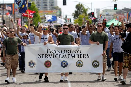 This July 16, 2011 file photo shows members of the military marching in the Gay Pride Parade in San Diego.