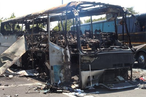 This image provided by the Bulgarian Interior Ministry Thursday July 19, 2012, shows a damaged bus following Wednesday's deadly suicide attack on a bus full of Israeli vacationers at the Burgas airport parking lot, Burgas, Bulgaria. (AP Photo)
