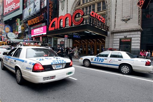 "Police officers are seen outside a movie theater screening ""The Dark Knight Rises,"" Friday, July 20, 2012 in New York. (AP Photo/Mary Altaffer)"