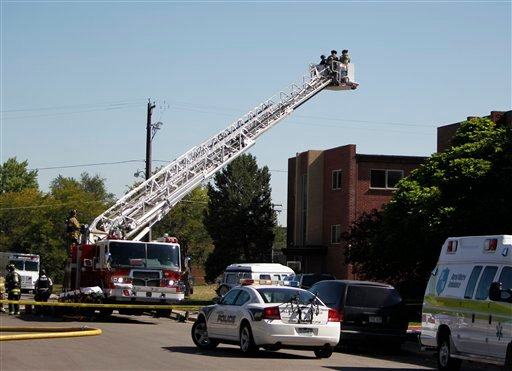 Police use the bucket on a fire truck to look down on an apartment where the suspect in a theatre shooting lived in Aurora, Colo., on Friday, July 20, 2012. (AP Photo/Ed Andrieski)