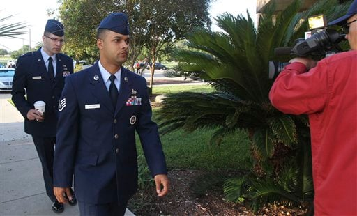 Air Force Staff Sgt. Luis Walker, left foreground, arrives for the fourth day of his trial at Lackland Air Force Base in San Antonio, Texas, Friday, July 20, 2012. (AP Photo/San Antonio Express News, Billy Calzada)
