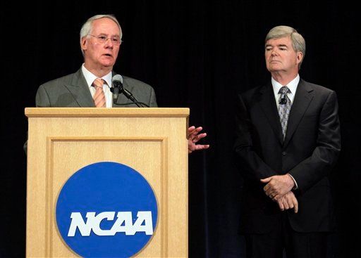 Ed Ray, left, NCAA Executive Committee chair and Oregon State University president, answers questiong about the penalties against Penn State as NCAA President Mark Emmert, looks on during a news conference in Indianapolis, Monday, July 23, 2012.