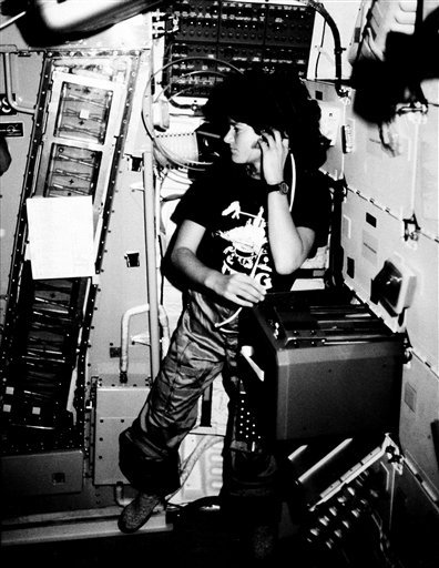 In this June 1983 file photo provided by NASA, astronaut Sally K. Ride, STS-7 mission specialist, communicates with ground controllers from the mid-deck of the earth-orbiting Space Shuttle Challenger. (AP Photo/NASA, File)