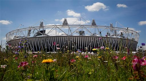 The Olympic Stadium is visible beyound an installation of artificial wildflowers in the Olympic Park at the 2012 London Summer Olympics, Sunday, July 22, 2012, in London. The opening ceremonies of the Olympic Games are scheduled for Friday, July 27. (AP)