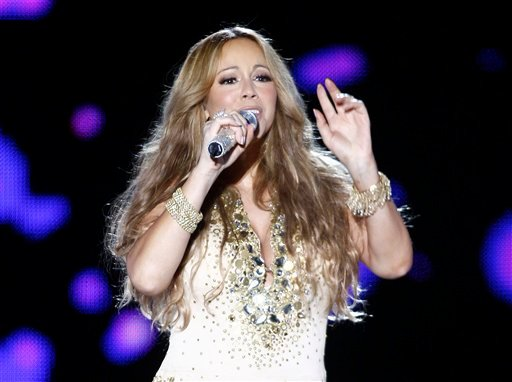 "FILE - This May 26, 2012 file photo shows U.S. Singer Mariah Carey performing on stage during a concert at the Mawazine Festival in Rabat, Morocco. Carey will be joining the cast of ""American Idol."" AP Photo/Abdeljalil Bounhar, file)"