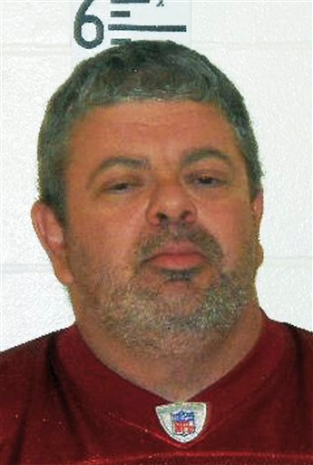 This booking photograph released by the Maine State Police shows Timothy Courtois, who was arrested Sunday, July 22, 2012 on charges of having a concealed weapon and speeding on the Maine Turnpike. Courtois told authorities he was on his way to Derry, N.H