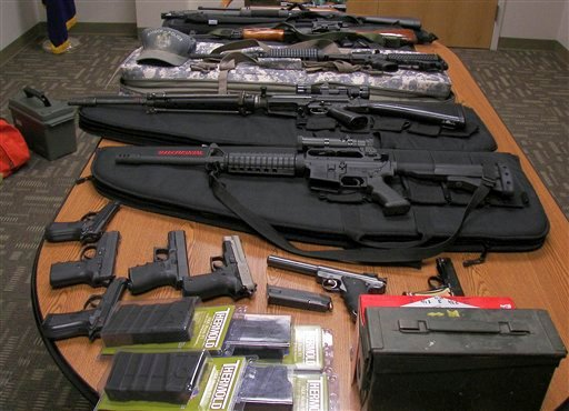 This undated photograph released by the Maine State Police shows weapons gathered from the home and vehicle of Timothy Courtois, of Biddeford, Maine, who was arrested Sunday, July 22, 2012 on charges of having a concealed weapon and speeding on the Maine