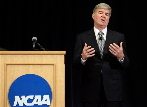 NCAA President Mark Emmert gestures during a news conference in Indianapolis, Monday, July 23, 2012.  (AP Photo/Michael Conroy)