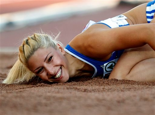 Greece's Voula Papachristou lands in the sand after her jump at the Women's Triple Jump final at the European Athletics Championships in Helsinki, Finland, in this file photo dated Friday, June 29, 2012.