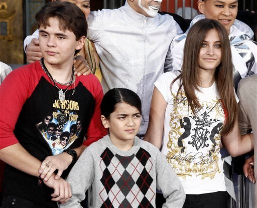 FILE - This Jan. 26, 2012 file photo shows, from left, Prince Jackson, Blanket Jackson and Paris Jackson after a hand and footprint ceremony honoring their father musician Michael Jackson in front of Grauman's Chinese Theatre in Los Angeles. (AP Photo)