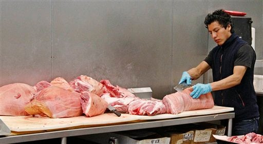 Butcher Freddie Quina cuts meat at Super Cao Nguyen in Oklahoma City, Wednesday, July 25, 2012. The record drought gripping half the country will help push food prices up by 3 percent to 4 percent next year, the U.S. Department of Agriculture said. (AP)