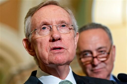 Senate Majority Leader Harry Reid, D-Nev., speaks to reporters just after Senate Democrats passed their version of a yearlong tax cut extension bill by a near party-line 51-48 vote, at the Capitol in Washington July 25, 2012.(AP Photo/J. Scott Applewhite)