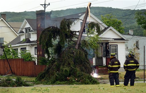 Elmira N.Y., firefighters watch an electric wire fire closely after a possible tornado struck the area, Thursday, July 26, 2012, in Elmira N.Y.