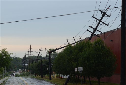 A row of broken power lines reveal the path that a tornado took after it struck Elmira N.Y., Thursday, July 26, 2012.