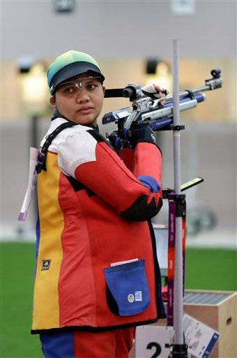 Malaysian shooting athlete Nur Suryani Mohamed Taibi, who is eight months pregnant, trains for the 10-meter air rifle event.