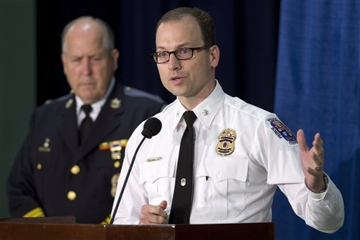 Prince George's County Police Chief Mark Magaw listens at left as Deputy Chief Henry Stawinski, with the Bureau of Forensic Science and Intelligence, speaks at a news conference at the Prince George's County Police Headquarters in Palmer Park, Md. (AP)