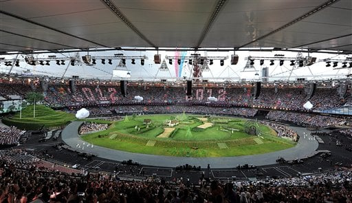 The Olympic Stadium prepares for the Opening Ceremony of the 2012 Summer Olympic Games on Friday, July 27, 2012, in London. (AP Photo/Martin Rickett, PA)
