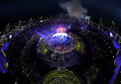 The Olympic rings light up the stadium during the Opening Ceremony at the 2012 Summer Olympics, Friday, July 27, 2012, in London. (AP Photo/David J. Phillip)