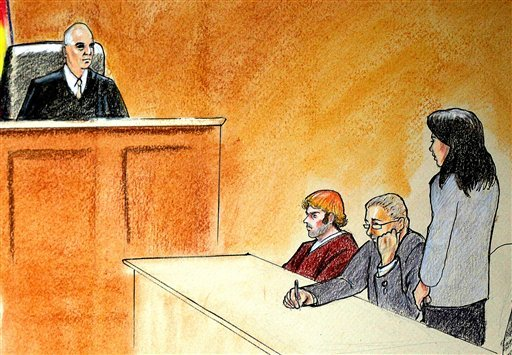 In this courtroom sketch, suspect James Holmes, third from right, sits in district court Monday, July 30, 2012, in Centennial, Colo., during his arraignment. (AP Photo)
