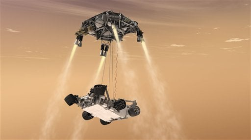 "FILE - In this 2011 file artist's rendering provided by NASA/JPL-Caltech, a ""sky crane"" lowers the Mars Science Laboratory Curiosity rover onto the surface of Mars. (AP Photo/NASA/JPL-Caltech, file)"