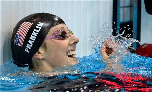 United States' Missy Franklin reacts after winning gold in the women's 100-meter backstroke swimming final at the Aquatics Centre in the Olympic Park during the 2012 Summer Olympics in London, Monday, July 30, 2012. (AP Photo/Mark J. Terrill)