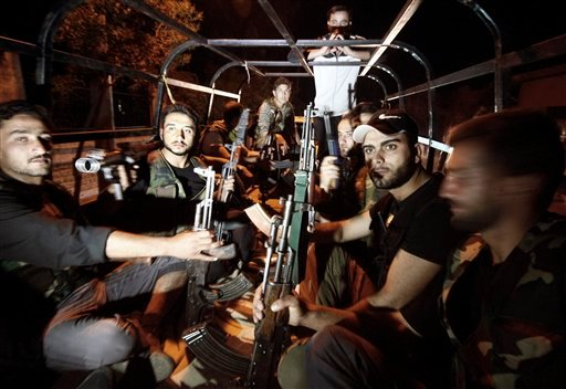In this Sunday, July 29, 2012 photo, Free Syrian Army soldiers are seen at the border town of Azaz, some 20 miles (32 kilometers) north of Aleppo, Syria. (AP Photo/Turkpix)